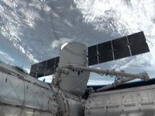 The SpaceX Dragon cargo vehicle<br /> is berthed to the International<br /> Space Station&#39;s Harmony module.<br /> Image credit: NASA TV
